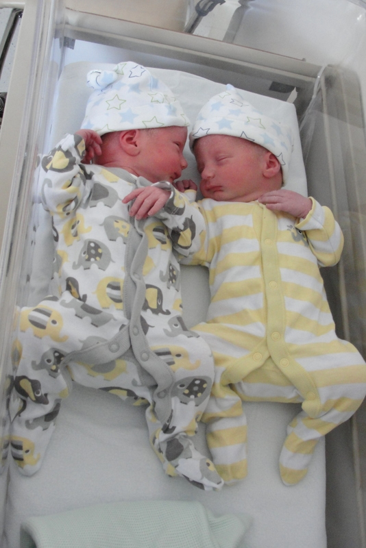George models this season's must-have elephant motif sleepsuit, while Robin looks splendid in yellow stripes